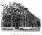 Steel frame building under construction at Alaska Gastineau Mining Company's mill, Thane, ca. 1920