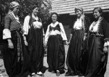 Young Catholic women wearing regional costumes from the 1930s, 1900s, and 1880s, Lipenica region, Bosnia and Hercegovina (former Yugoslavia), 1937